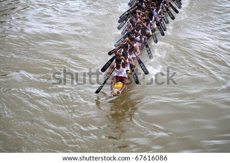 KOTTAYAM, INDIA - AUGUST 29 : A Snake boat team in the Kottayam Boat race on August 29, 2010 in Kottayam, India.