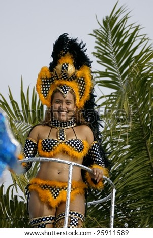 KOUROU, FRENCH GUIANA - FEBRUARY 15: A beautiful Brazilian dancer participated in the main carnival parade February 15, 2009 in Kourou, French Guiana. Almost 60 groups participated this year.