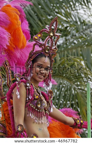 KOUROU, FRENCH GUIANA - FEBRUARY 7: A beautiful Brazilian dancer participates in French Guiana's Annual Carnival February 7, 2010 in Kourou, French Guiana. Almost 50 groups participated this year.