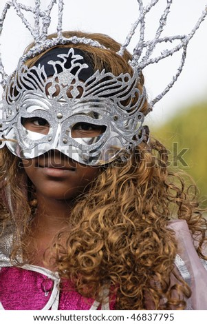 KOUROU, FRENCH GUIANA - FEBRUARY 7: A mysterious parade-goer participates in French Guiana's Annual Carnival February 7, 2010 in Kourou, French Guiana. Almost 50 groups participated this year.