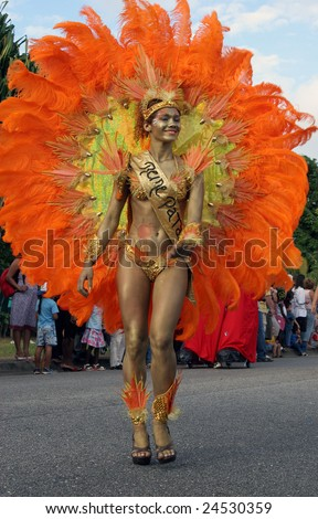 KOUROU, FRENCH GUIANA - JANUARY 28: the queen of a Brazilian group participates in the main carnival parade January 28, 2008 in Kourou, French Guiana. The yearly theme contest is ORANGE.