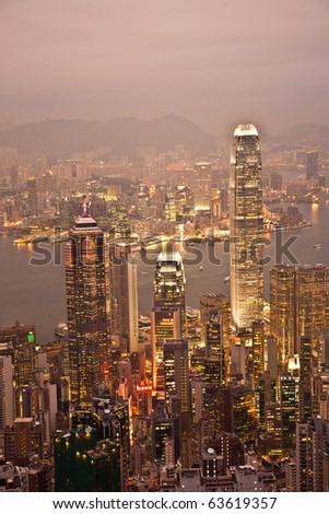 KOWLOON, HONGKONG - JAN. 05: Hong Kong view from Victoria Peak to the bay and the illuminated skyscraper  by night on January 5, 2010, Kowloon, Hongkong.