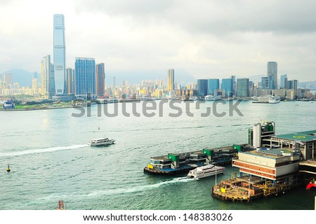 Kowloon island at sunset.  Ferry pier from Hong Kong to Macao on the right.