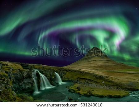 Kp 5 northern light over Kirkjufell mountain in iceland\n