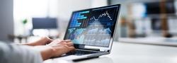KPI Business Analytics Dashboard On Laptop Computer