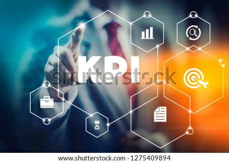 KPI business man selecting word KPI meaning key performance indicator. Metrics for company and worker management and success.