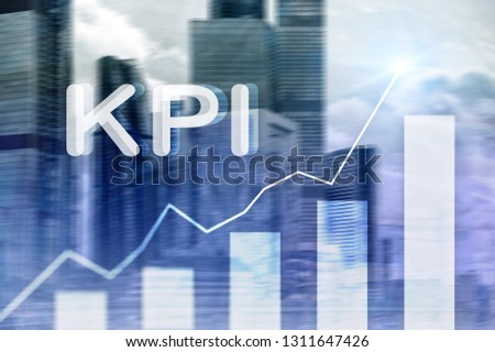KPI - Key Performance Indicator. Business and technology concept. Multiple exposure, mixed media. Financial concept on blurred background.