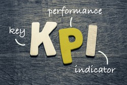 KPI (key performance indicator) on wood background
