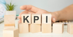 KPI - wooden blocks with letters, key performance indicator KPI concept, top view on white background
