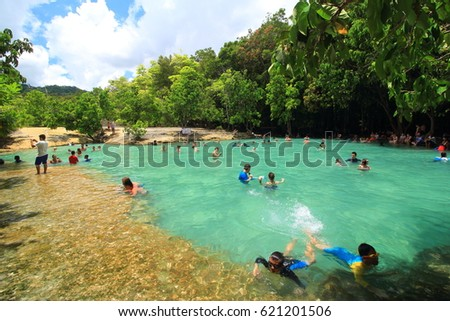 Krabi, Thailand - April 12, 2017 :A lot of tourists enjoy swimming in the emerald pool at Krabi, Thailand