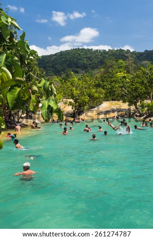 KRABI,THAILAND- FEBRUARY 28: ,Many tourists to swimming playfully during the high season in emerald pond on 28 February 2015 at Krabi,Thailand