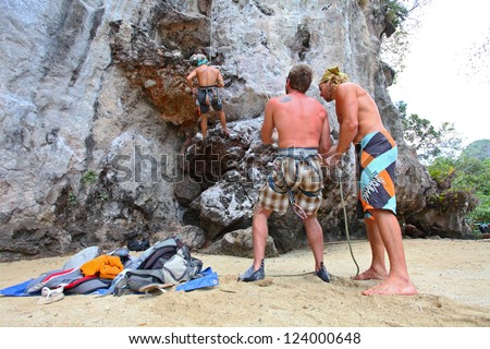 KRABI, THAILAND - JANUARY 25 : Rock climbing on Railay beach on January 25, 2011 in Krabi, Thailand. Railay beach is one of the most popular rock climbing locations in Asia.