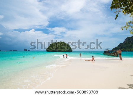 Krabi Thailand - 2016 September 18 - Long tail boats and tourist at Unseen beach, Tub Island, Andaman Sea, Thailand at Krabi Thailand  #500893708