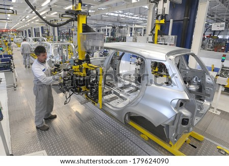 KRAGUJEVAC SERBIA CIRCA APRIL 2012 Workers assembles cars at Fiat Cars Serbia factory circa April 2012 in Kragujevac