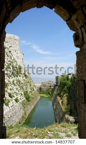 Krak des Chevaliers, citadel tower, fortification castle walls , crusaders fortress, Syria - stock photo