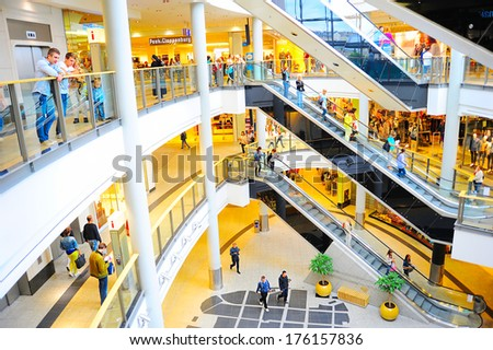 KRAKOW, POLAND - AUGUST 26, 2013: Unidentified people at Galeria Krakowska in Krakow, Poland. Galeria Krakowska has 270 specialty shops and restaurants in two roof-covered shopping malls  - stock photo
