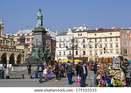 KRAKOW, POLAND - FEBRUARY 26, 2014: Monument to Adam Mickiewicz, polish poet, political activist and journalist, built according to the project of Theodore Rygier, unveiled on June 16, 1898