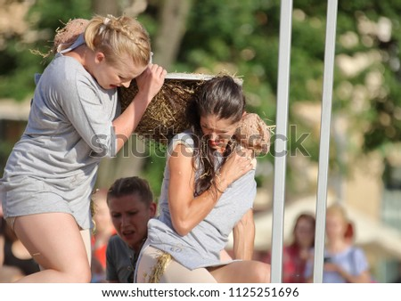 Krakow / Poland - July 6 2017: International Festival of Street Theatre 2017, The Group the Dragonfly Actions shows performance titled Pose, main market square, audience #1125251696