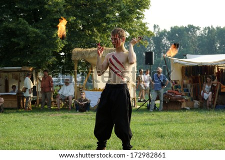 KRAKOW, POLAND - JUNE 21: St. John\'s Fair festival\'s fire show on June 21, 2013 in Krakow, Poland. In this performance the actors are fighting with the dragon