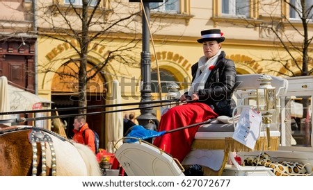 Krakow, Poland - March 27, 2017: Horse carriages at main market square in Krakow. #627072677