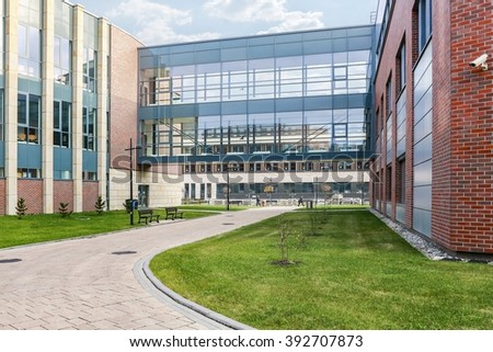 KRAKOW,POLAND - NOVEMBER 12, 2015: The Jagiellonian University. The oldest university in Poland, the second oldest university in Central Europe. Modern campus buildings in Krakow, Poland. #392707873