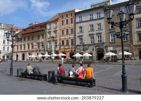 KRAKOW, POLAND - SEPTEMBER 15, 2013: People resting on the Little Market square. This square sometimes used as the spot for fairs, festivals, promotions and smaller events