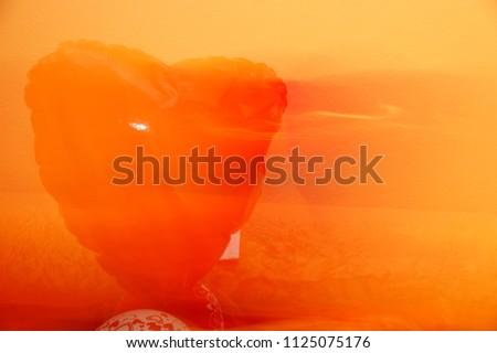 Krasnodar, RUSSIA - December 5, 2013: A floating ghostly heart on an orange background, Krasnodar Territory, Russia December 5, 2013  #1125075176