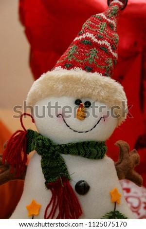 Krasnodar, RUSSIA - December 5, 2013: Cheerful teddy snowman close-up, christmas toy, Krasnodar Territory, Russia December 5, 2013  #1125075170
