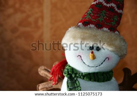 Krasnodar, RUSSIA - December 5, 2013: Cheerful teddy snowman close-up, christmas toy, Krasnodar Territory, Russia December 5, 2013  #1125075173