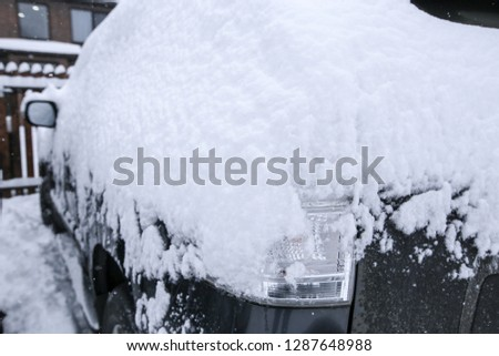 Krasnodar, Russia-December 26, 2018. Snow on cars after snowfall. Extreme snowfall in european city  #1287648988