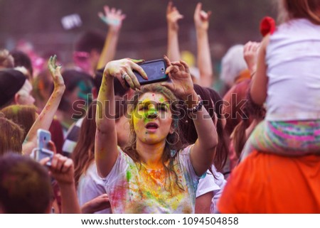 KRASNODAR, RUSSIA - May11,2018: Festival of colors, traditional Indian festival of Holi. Young people have fun during Holi holiday, throwing colorful powder. Festival of colored paint. Color festival #1094504858