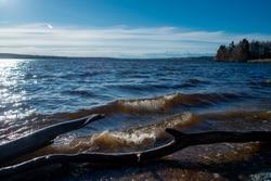 Krasnogvardeyskoe lake in  Vyborgsky district of Leningrad region. Coast of wide blue lake with swash on sunny evening. Karelian isthmus. Russia.