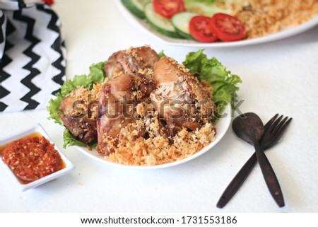 Kremes chicken is a dish made from chicken made with fried technique. Crispy chicken is fried in a spiced flour which has been seasoned, and fried until browned and giving the sensation of crunchy  Stock fotó ©