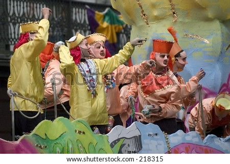 Krewe throwing beets on Canal street parade during Mardi Gras in New Orleans, LA