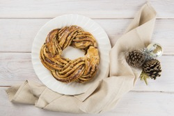 Kringle or pretzel, traditional Christmas dessert in Northen Europe with cinnamon and walnuts