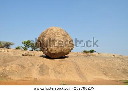 Krishna's butterball balancing giant rock, India