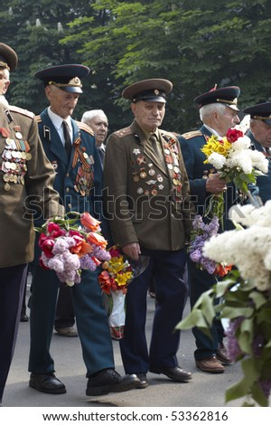 KRIVOY ROG, UKRAINE - MAY 9 : Ukrainian veterans of the Second World War walking at parade May 09, 2010 in Krivoy Rog, Ukraine. Celebration of day of a victory in the Second World War.