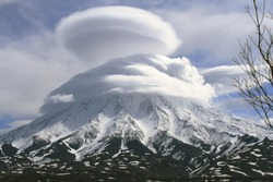 Kronotsky volcano in the  houve of the clouds, Kamchatka, Russia