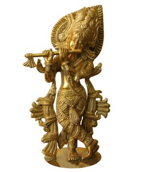 Krsna is the supreme personality of God. Krishna is playing the flute. Indian sculpture isolated on white background.