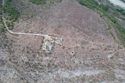 Krumograd, Bulgaria - 08 28 2021: Old ruined building on one of the hills near the town of Krumovgrad