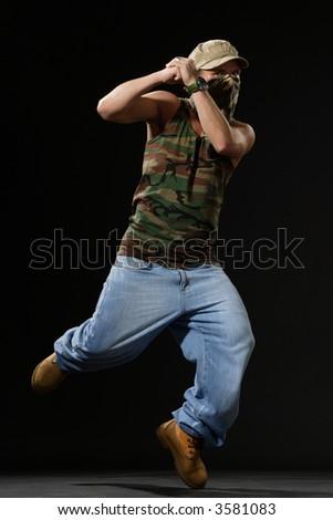 krump style dancer jumping on leg
