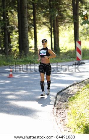 KRYNICA-ZDROJ, POLAND - SEPT 11: The runner Balbus Anna is running a marathon (control point 39km) at Economic Forum Polish Running Festival September 11, 2011 in Krynica-Zdroj, Poland