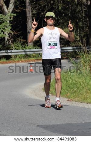 KRYNICA-ZDROJ, POLAND - SEPT 11:: The runner Bodanka Piotr is running a marathon (control point 39km) at Economic Forum Polish Running Festival September 11, 2011 in Krynica-Zdroj, Poland