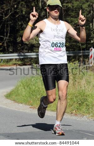 KRYNICA-ZDROJ, POLAND - SEPT 11: The runner Bodanka Piotr is running a marathon (control point 39km) at Economic Forum Polish Running Festival September 11, 2011 in Krynica-Zdroj, Poland