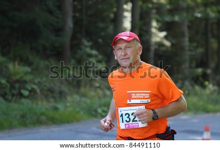 KRYNICA-ZDROJ, POLAND - SEPT 11: The runner Brzozowski Leszek is running a marathon (control point 39km) at Economic Forum Polish Running Festival September 11, 2011 in Krynica-Zdroj, Poland