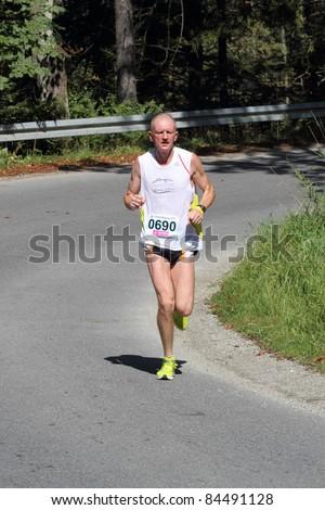 KRYNICA-ZDROJ, POLAND - SEPT 11:The runner Kopcewicz Robert is running a marathon (control point 39km) at Economic Forum Polish Running Festival September 11, 2011 in Krynica-Zdroj, Poland