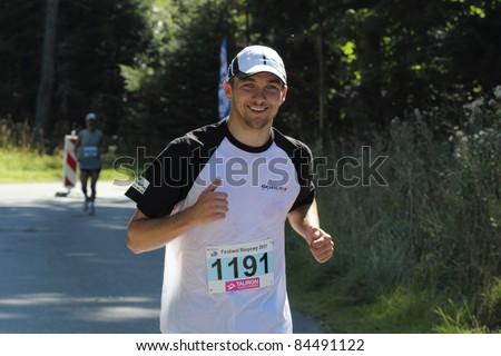 KRYNICA-ZDROJ, POLAND - SEPT 11:The runner Krzemien Pawel is running a marathon (control point 39km) at Economic Forum Polish Running Festival September 11, 2011 in Krynica-Zdroj, Poland