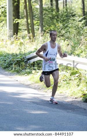 KRYNICA-ZDROJ, POLAND - SEPT 11: The runner Labuz Marek is running a marathon (control point 39km) at Economic Forum Polish Running Festival September 11, 2011 in Krynica-Zdroj, Poland
