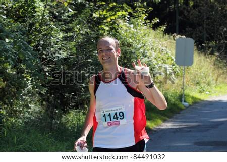 KRYNICA-ZDROJ, POLAND - SEPT 11: The runner Mastalerz Tomasz is running a marathon (control point 39km) at Economic Forum Polish Running Festival September 11, 2011 in Krynica-Zdroj, Poland