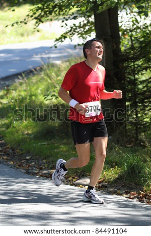 KRYNICA-ZDROJ, POLAND - SEPT 11: The runner Niedziela Slawomir is running a marathon (control point 39km) at Economic Forum Polish Running Festival September 11, 2011 in Krynica-Zdroj, Poland